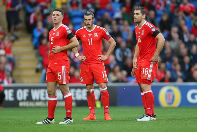 CARDIFF, WALES - OCTOBER 09: James Chester, Gareth Bale and Sam Vokes of Wales during the FIFA 2018 World Cup Qualifier between Wales and Georgia at Cardiff City Stadium on October 9, 2016 in Cardiff, Wales. (Photo by Catherine Ivill - AMA/Getty Images)