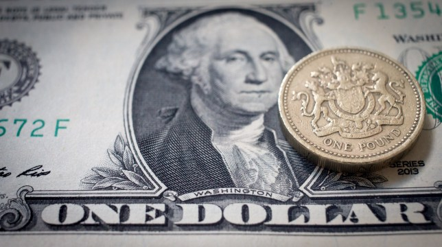BATH, ENGLAND - OCTOBER 10:  In this photo illustration,  a one pound sterling coin can be seen on top of a US dollar bill on October 10, 2016 in Bath, England. Since the UK voted to leave the European Union in June, the UK's currency has been fluctuating in value against other currencies, including the Euro and the dollar, and looks likely to remain doing so while the uncertainty remains surrounding the terms of the UK's departure from the EU.  (Photo by Matt Cardy/Getty Images)