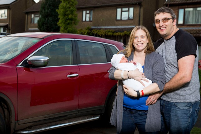 """Stuart Blaze (40), Sarah Blaze (35), William Blaze (2 days), at their home in The Hobbins, Bridgnorth, Shropshire. An ambulance worker was forced to give birth in a car at the side of the road because she was too embarrassed and didn't want her colleagues to see her in an """"undignified state"""". See NTI story NTIBIRTH. Sarah Blaze, 35, was sent home from hospital and told she was in early labour at 10pm on Friday (11/11). But when her waters broke at home an hour later she refused to call an ambulance because she didn't want colleagues to see """"all of her"""". Instead she decided to get her husband Stuart, 40, to drive her 15 miles to New Cross Hospital in Wolverhampton, West Mids. The couple were forced to pull over on the Bridgnorth Road in Wightwick, West Mids., at 12.26am on Saturday (12/11) when Sarah felt the urge to push. Incredibly, Stuart didn't even have time to get out of the driver's seat before he had to help deliver William in their red Nissan X-Trail. The heroic dad even managed unwrap the umbilical cord which had got stuck around the newborn baby's neck. An ambulance then arrived two minutes later to take Sarah and William, who weighed 8lbs 2ozs, to hospital to be checked over."""