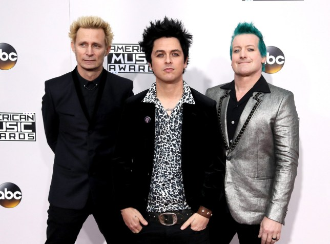LOS ANGELES, CA - NOVEMBER 20: (L-R) Musicians Mike Dirnt, Billie Joe Armstrong and Tr Cool of Green Day attend the 2016 American Music Awards at Microsoft Theater on November 20, 2016 in Los Angeles, California. (Photo by David Livingston/Getty Images)