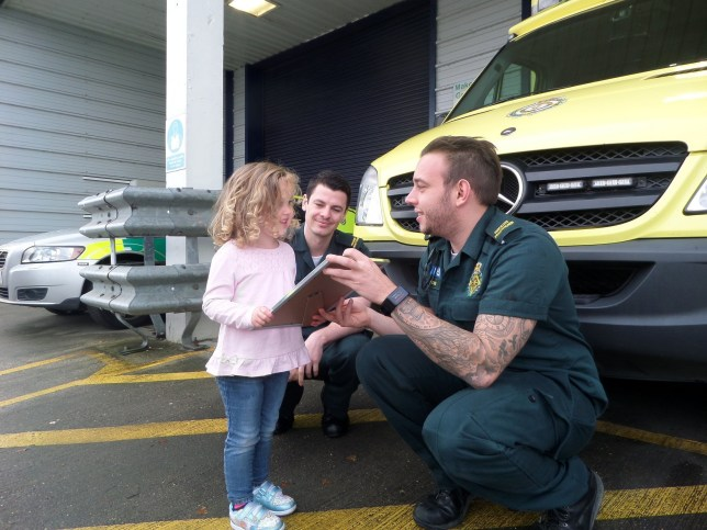 Isabelle Solly being given a certificate after she dialled 999 after her mum collapsed at the family home in Snodland, Kent. See National copy NNCALL: A three-year-old girl astonished hardened emergency call operators after her mum collapsed - by dialling 999 and directing paramedics to her house. Despite being just three years old, clever Isabelle Solly had the wherewithal to raise the alarm after finding her mum Kay on the floor, unconscious. With her dad away at work, brave Isabelle took matters into her own, tiny, hands and called 999 - and clearly explained had happened and that she needed an ambulance for her mummy. Credit: SWNS