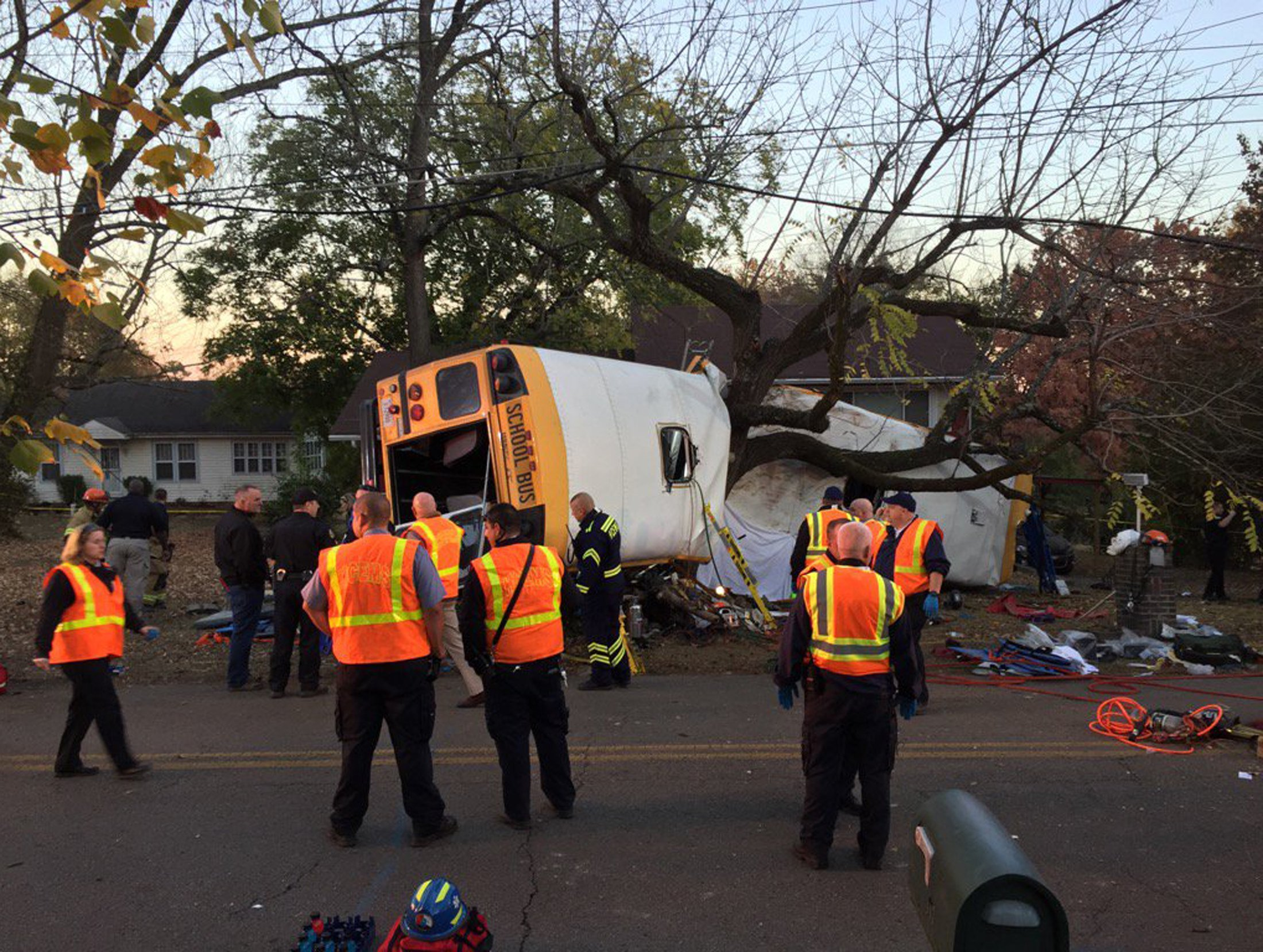 Rescue officials at the scene of a school bus crash involving several fatalities in Chattanooga, Tennessee, U.S., November 21, 2016. Courtesy of Chattanooga Fire Dept/Handout via REUTERS ATTENTION EDITORS - THIS IMAGE WAS PROVIDED BY A THIRD PARTY. EDITORIAL USE ONLY