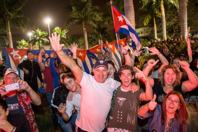 epa05647963 Members of the Cuban community of Miami celebrate the death of former Cuban President Fidel Castro at the popular Cuban restaurant Versailles in Little Havana neighborhood of Miami, Florida, USA, 26 November 2016. According to a Cuban state TV broadcast, Cuban former President Fidel Castro has died at the age of 90 on 25 November 2016. EPA/GASTON DE CARDENAS