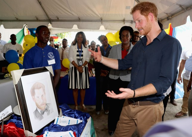 Prince Harry is presented with a portrait on Grand Anse Beach as he visits Mangrove restoration projects ahead of visiting the coral reef in Grenada during the second leg of his Caribbean tour. PRESS ASSOCIATION Photo. Picture date: Monday November 28, 2016. See PA story ROYAL Harry. Photo credit should read: Chris Jackson/PA Wire