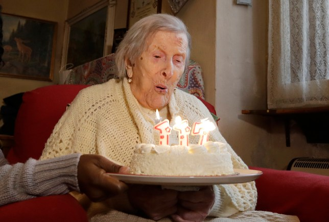 Emma Morano, 117 years old, blows candles in the day of her birthday in Verbania, Italy, Tuesday, Nov. 29, 2016. At 117 years of age, Emma is now the oldest person in the world and is believed to be the last surviving person in the world who was born in the 1800s, coming into the world on Nov. 29, 1899. (AP Photo/Antonio Calanni)