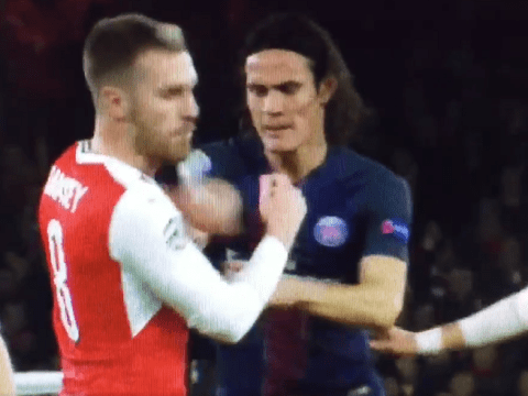 Edinson Cavani escapes red card after PUNCHING Aaron Ramsey during Arsenal's clash with Paris Saint-Germain