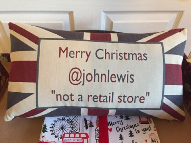 John Lewis' Christmas present cushion sent by John Lewis