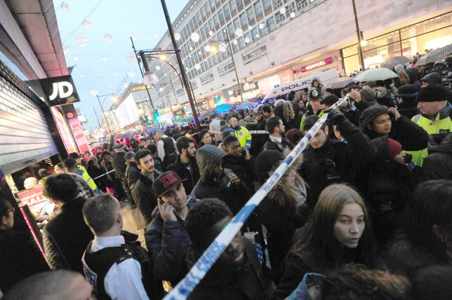 Pictured: The police are called to JD sports on boxing day after a fight breaks out over the sales. The police evacuated JD and put a cordon in place outside. Oxford street traffic came to a stand still in both directions and caused chaos in people congestion as shoppers tried to get to the shops around. . REXMAILPIX.