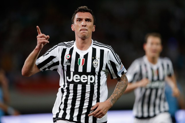 SHANGHAI, CHINA - AUGUST 08:  Mario Mandzukic of Juventus FC in celebrates a goal during the Italian Super Cup final football match between Juventus and Lazio at Shanghai Stadium on August 8, 2015 in Shanghai, China.  (Photo by Lintao Zhang/Getty Images)