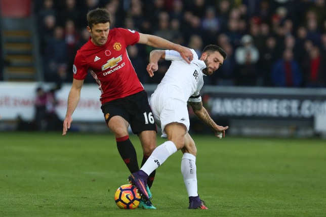 Manchester United's English midfielder Michael Carrick (L) vies with Swansea City's Spanish striker Borja during the English Premier League football match between Swansea City and Manchester United at The Liberty Stadium in Swansea, south Wales on November 6, 2016. / AFP / GEOFF CADDICK / RESTRICTED TO EDITORIAL USE. No use with unauthorized audio, video, data, fixture lists, club/league logos or 'live' services. Online in-match use limited to 75 images, no video emulation. No use in betting, games or single club/league/player publications.  /         (Photo credit should read GEOFF CADDICK/AFP/Getty Images)