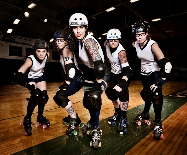 "The Port Authorities Roller Derby Team, one of two that comprise the Maine Roller Derby Association. Members are, from left: Aerin Jenkins, ""Crystal Whip"", Sarah Caron, ""Fist City Kitty""; Lisa Bassett, ""Olive Spankins""; Amy Martin, ""Punchy O'Guts""; and Maureen Wissman, ""Killer Quick""."