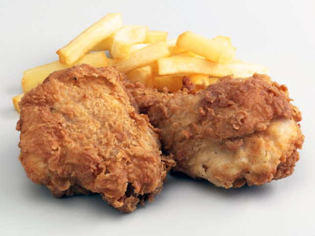 Two deep fried chicken and chips