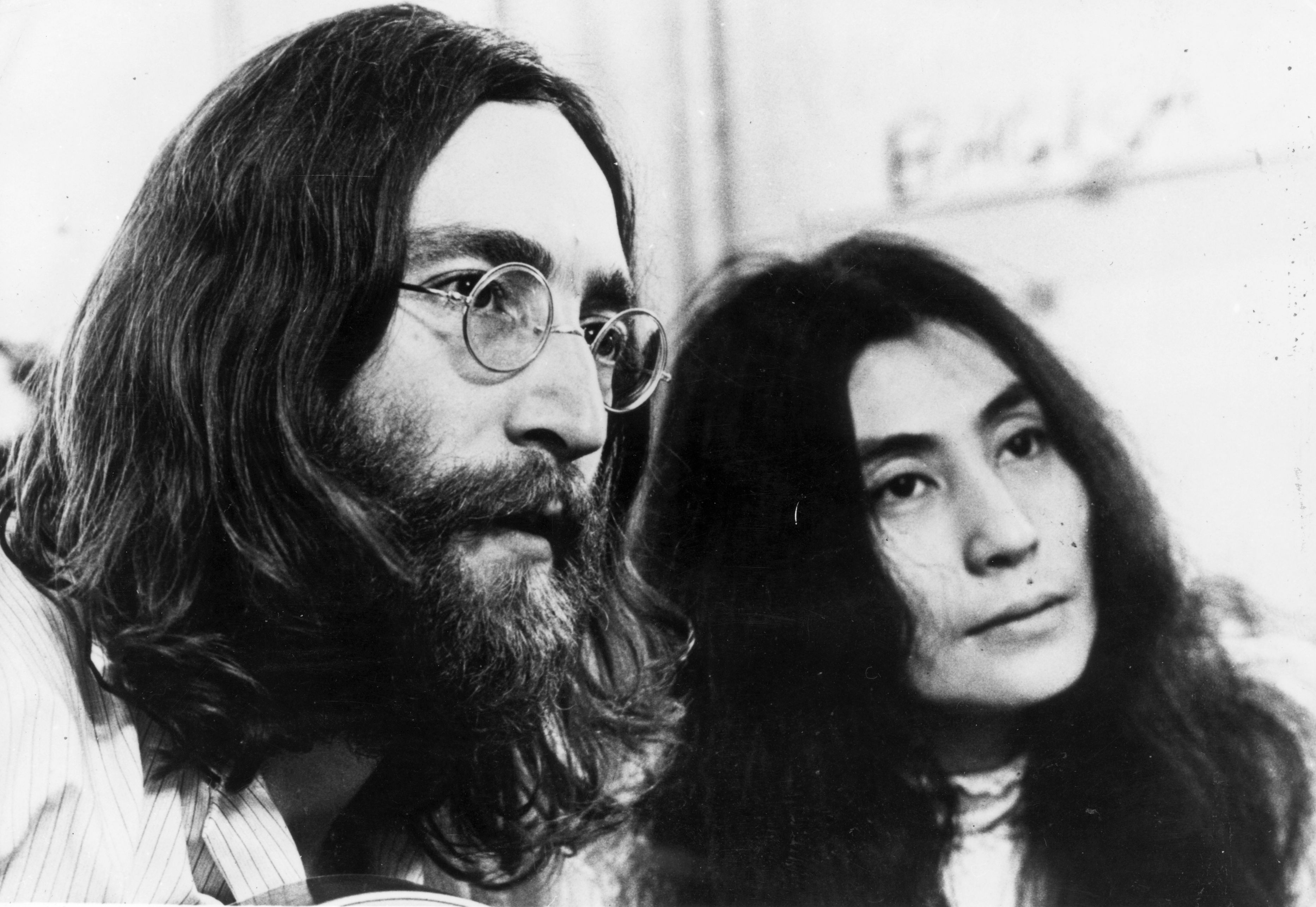 1969: John Lennon (1940 -1980), singer, songwriter and guitarist of British pop group The Beatles, with his wife Yoko Ono listening to the playback of one of their tapes. (Photo by Keystone Features/Getty Images)