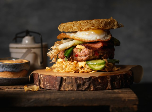 Ramen burger with fried egg, aioli sauce, cucumbers, leeks and bacon.