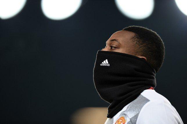 Manchester United's French striker Anthony Martial warms up ahead of the EFL (English Football League) Cup quarter-final football match between Manchester United and West Ham United at Old Trafford in Manchester, north west England, on November 30, 2016. / AFP / Oli SCARFF / RESTRICTED TO EDITORIAL USE. No use with unauthorized audio, video, data, fixture lists, club/league logos or 'live' services. Online in-match use limited to 75 images, no video emulation. No use in betting, games or single club/league/player publications. / (Photo credit should read OLI SCARFF/AFP/Getty Images)