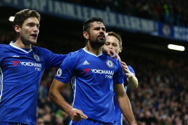 LONDON, ENGLAND - DECEMBER 31: Diego Costa (C) of Chelsea celebrates scoring his team's fourth goal during the Premier League match between Chelsea and Stoke City at Stamford Bridge on December 31, 2016 in London, England. (Photo by Steve Bardens/Getty Images)