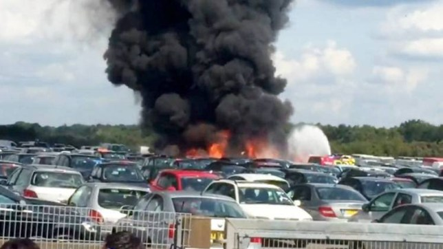 A pilot was feared dead yesterday (Fri) after a plane crashed near an airport. See SWNS story SWPLANE. The light aircraft came down yesterday afternoon and was seen burning in a car park beside Blackbushe Airport, in Camberley, Hampshire. Plumes of black smoke filled the air above the airport after it crashed into the British Car Auctions site next door to the airport. Hampshire Constabulary were called at 3.09pm to the airport yesterday after receiving calls of a plane crash. Witnesses said they saw the plane overshoot the runway before bursting into flames.