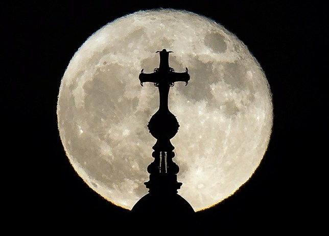 A supermoon rises above St. Paul's Cathedral in central London on December 14, 2016. The phenomenon happens when the moon is full at the same time as, or very near, perigee -- its closest point to Earth on an elliptical, monthly orbit. / AFP PHOTO / Daniel LEAL-OLIVASDANIEL LEAL-OLIVAS/AFP/Getty Images