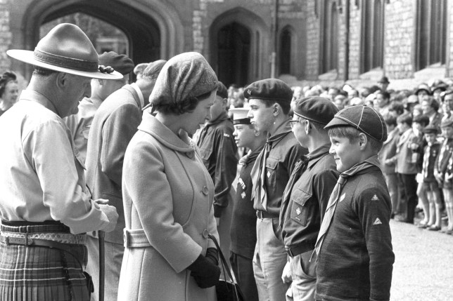 """File photo dated 27/4/1969 of Queen Elizabeth II talking to Cub Scout Paul Hewitt as she attends the annual St. George's Day parade of Queen's Scouts. The Queen and Prime Minister are among the famous faces who have offered their congratulations to the Cub Scouts on their 100th anniversary. PRESS ASSOCIATION Photo. Issue date: Friday December 16, 2016. In a letter to chief scout Bear Grylls, Her Majesty said she sent her """"best wishes"""" to those celebrating the occasion. See PA story EDUCATION Cubs. Photo credit should read: PA Wire"""