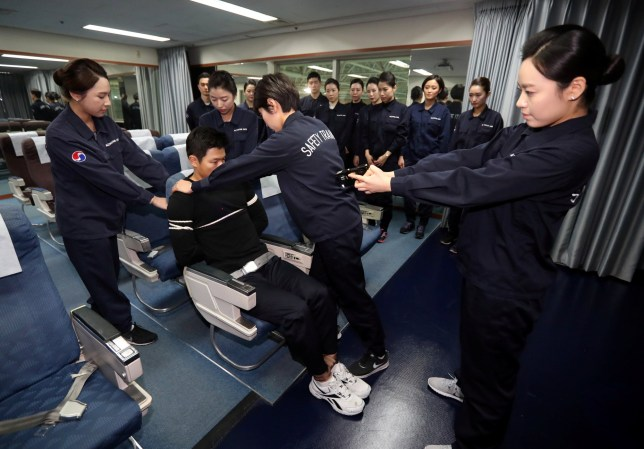 Cabin crews attend a training session on how to manage in-flight disturbances in Seoul, South Korea, December 27, 2016. Shin Joon-hee/Yonhap via REUTERS ATTENTION EDITORS - THIS IMAGE HAS BEEN SUPPLIED BY A THIRD PARTY. SOUTH KOREA OUT. FOR EDITORIAL USE ONLY. NO RESALES. NO ARCHIVE.