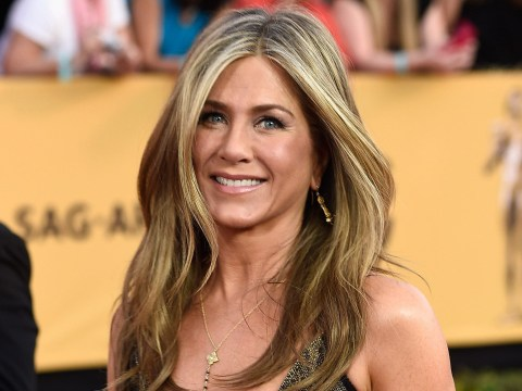 Jennifer Aniston will star in and produce a war movie but admits they're 'not my thing'