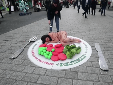 Woman lies down naked in protest against Christmas dinner