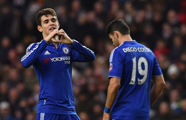 Chelsea's Brazilian midfielder Oscar (L) celebrates after scoring the opening goal of the English FA Cup fourth round football match between MK Dons and Chelsea at Stadium MK in Milton Keynes, central England, on January 31, 2016. / AFP / BEN STANSALL / RESTRICTED TO EDITORIAL USE. No use with unauthorized audio, video, data, fixture lists, club/league logos or 'live' services. Online in-match use limited to 75 images, no video emulation. No use in betting, games or single club/league/player publications. / (Photo credit should read BEN STANSALL/AFP/Getty Images)