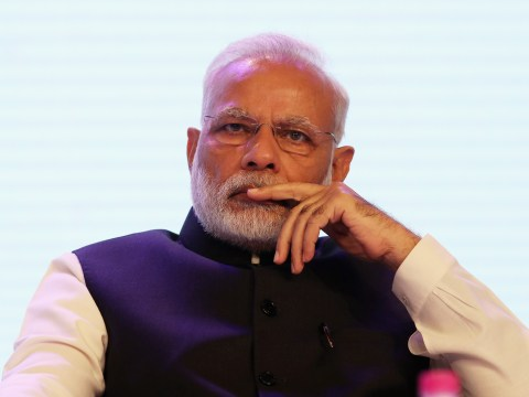 Who is Narendra Modi and why is he TIME Person of the Year in the reader poll?