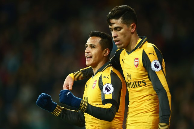 LONDON, ENGLAND - DECEMBER 03: Alexis Sanchez of Arsenal celebrates with Gabriel Paulista after scoring his team's second goal during the Premier League match between West Ham United and Arsenal at London Stadium on December 3, 2016 in London, England. (Photo by Jordan Mansfield/Getty Images)