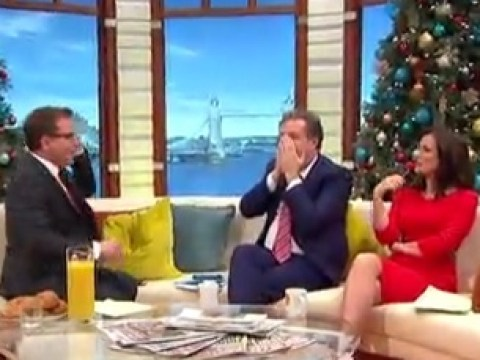 Piers Morgan and Richard Arnold caught checking their phones on air on Good Morning Britain