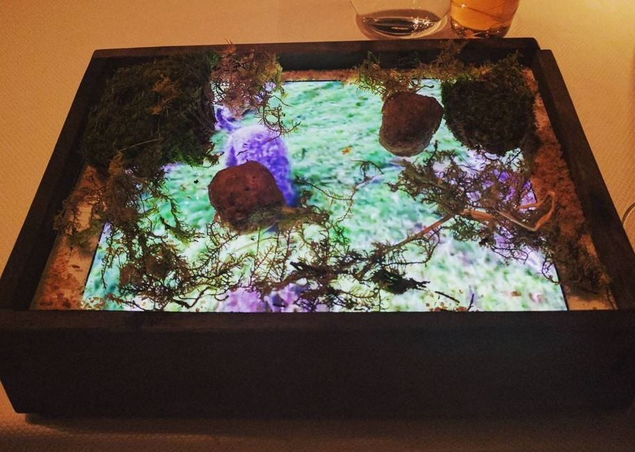 quince restaurants eating food on ipads