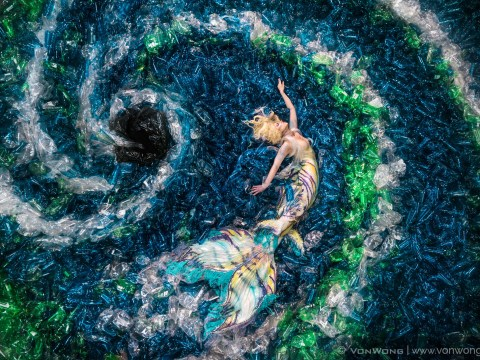 Mermaids are swimming through a 10,000 plastic bottle ocean to tell us about pollution