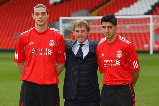 LIVERPOOL, ENGLAND - FEBRUARY 03: Kenny Dalglish the manager of Liverpool stands between his new signings, Andy Carroll (l) and Luis Suarez (r) during a photocall at Anfield on February 3, 2011 in Liverpool, England. (Photo by Alex Livesey/Getty Images)