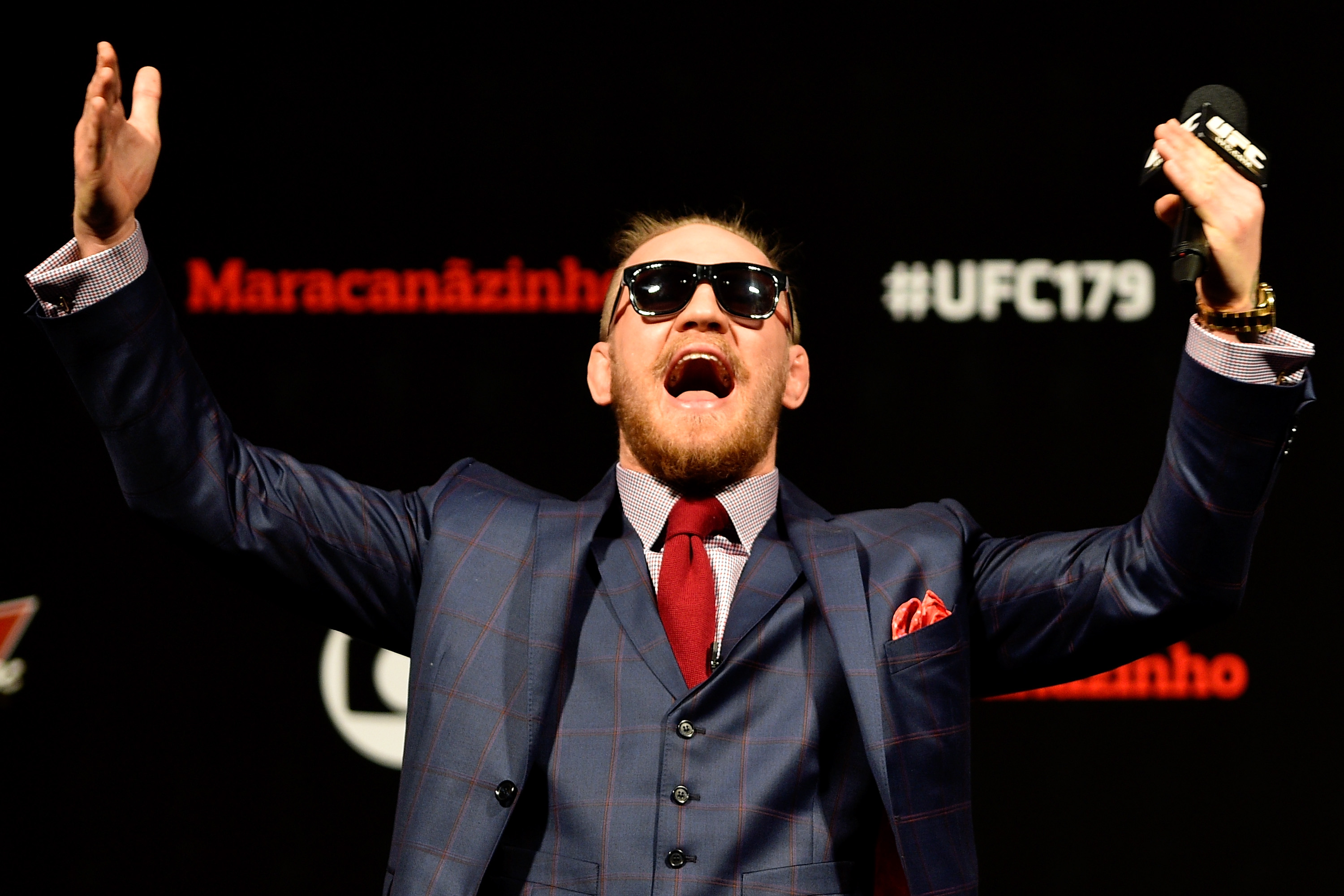 RIO DE JANEIRO, BRAZIL - OCTOBER 24: Conor McGregor of Ireland interacts with fans during a Q&A session before the UFC 179 weigh-in at Maracanazinho on October 24, 2014 in Rio de Janeiro, Brazil. (Photo by Buda Mendes/Getty Images)