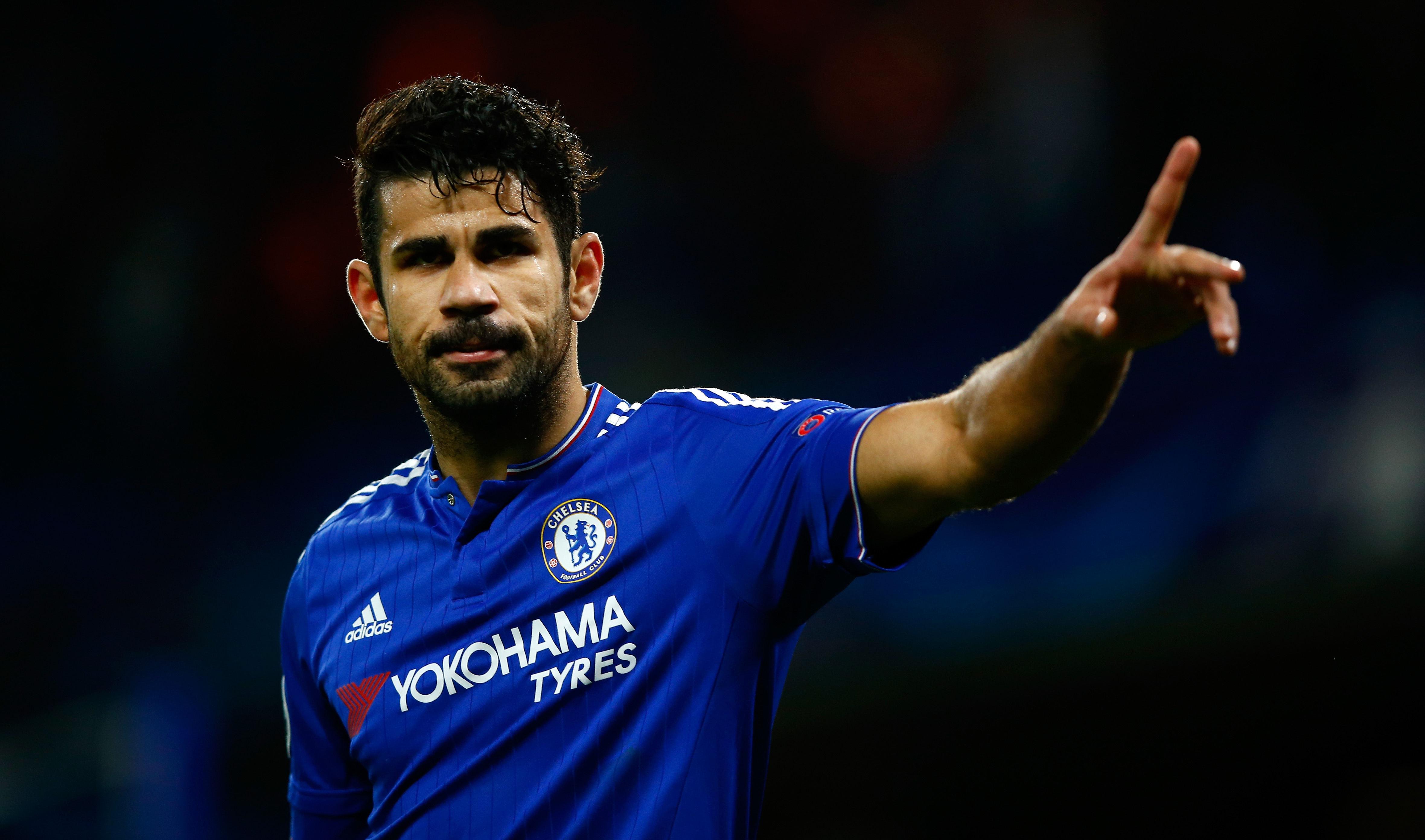 LONDON, ENGLAND - DECEMBER 09: Diego Costa of Chelsea celebrates the first Chelsea goal during the UEFA Champions League Group G match between Chelsea FC and FC Porto at Stamford Bridge on December 9, 2015 in London, United Kingdom. (Photo by Clive Rose/Getty Images)