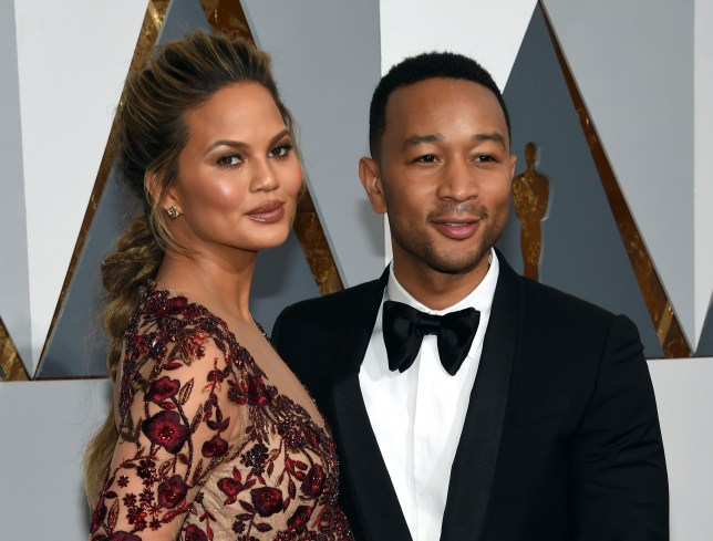 John Legend (pictured with wife Chrissy Teigen) has urged couples to seek IVF treatment if they struggle to conceive naturally (Picture: Ethan Miller/Getty Images)