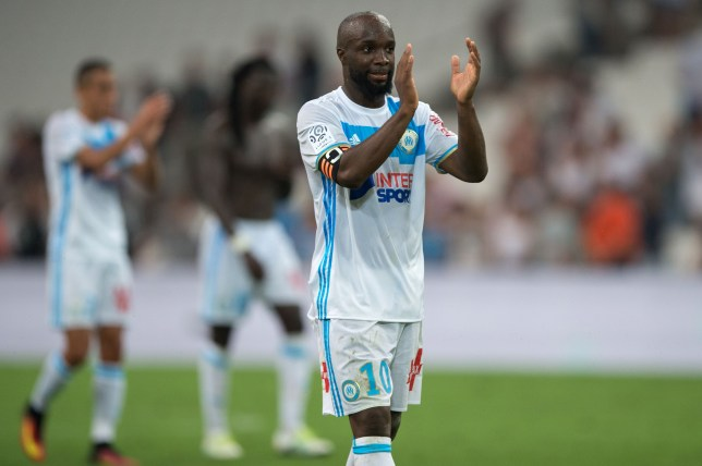 Olympique de Marseille's French midfielder Lassana Diarra applauses after the French Ligue 1 football match between Olympique de Marseille and Toulouse FC on August 14, 2016 at the Velodrome stadium in Marseille, southern France. / AFP / BERTRAND LANGLOIS (Photo credit should read BERTRAND LANGLOIS/AFP/Getty Images)
