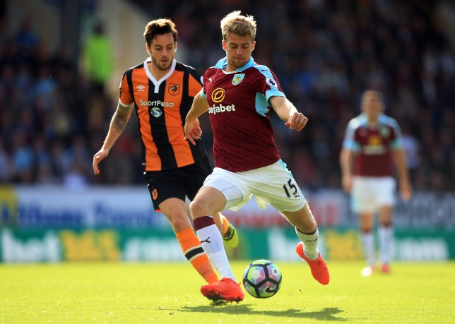 BURNLEY, ENGLAND - SEPTEMBER 10: Patrick Bamford of Burnley (R) shoots during the Premier League match between Burnley and Hull City at Turf Moor on September 10, 2016 in Burnley, England. (Photo by Ben Hoskins/Getty Images)
