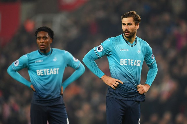 STOKE ON TRENT, ENGLAND - OCTOBER 31: Fernando Llorente (R) and Leroy Fer of Swansea City look thoughtful during the Premier League match between Stoke City and Swansea City at Bet365 Stadium on October 31, 2016 in Stoke on Trent, England. (Photo by Laurence Griffiths/Getty Images)