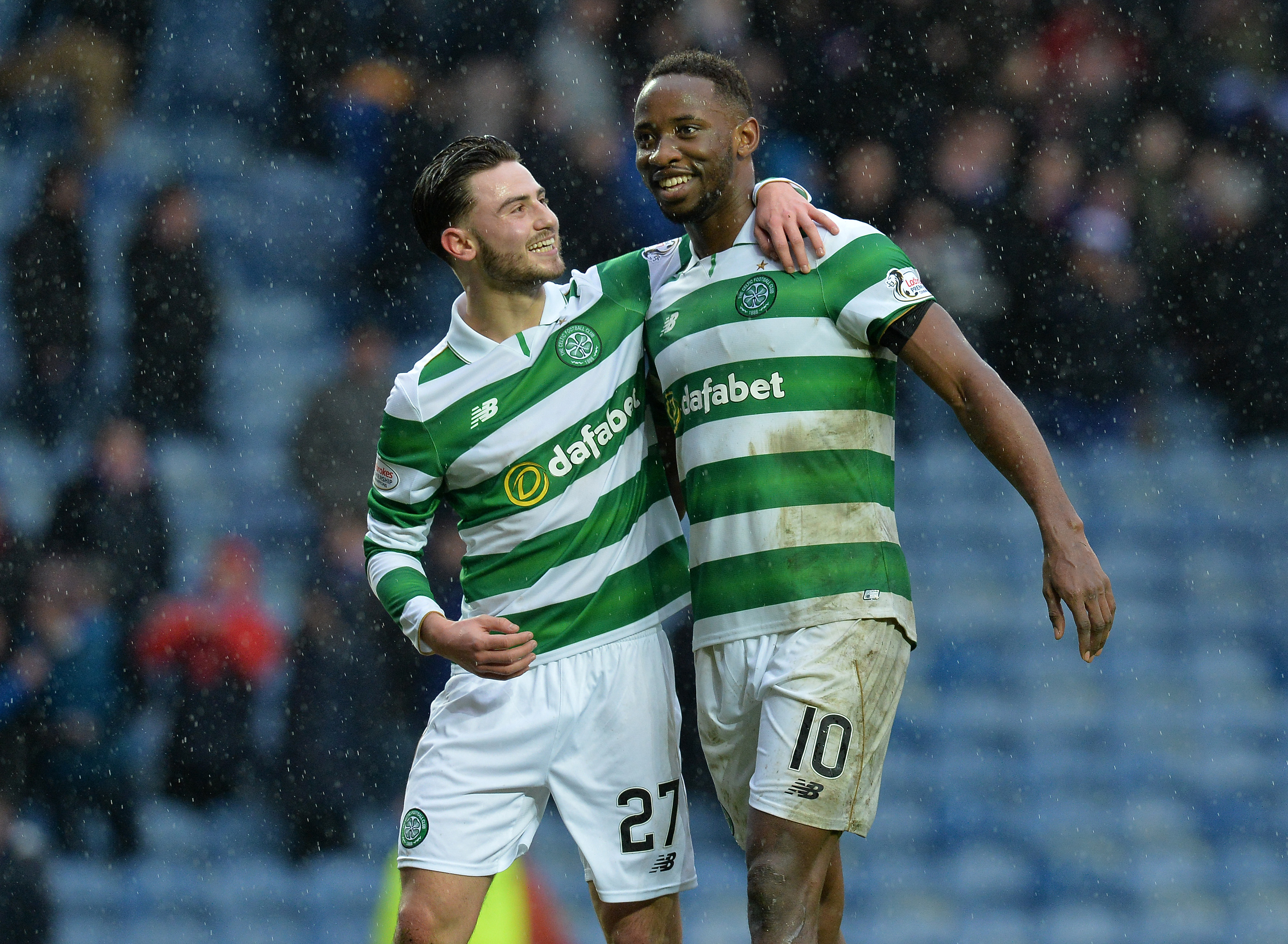 GLASGOW, SCOTLAND - DECEMBER 31: Moussa Dembele of Celtic celebrate at the final Whistle with team mate Patrick Roberts during the Scottish Premiership match between Rangers FC and Celtic FC at Ibrox Stadium on December 31, 2016 in Glasgow, Scotland. (Photo by Mark Runnacles/Getty Images)