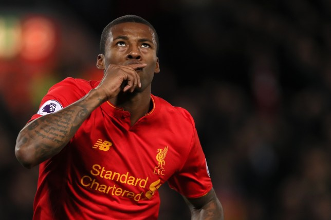 LIVERPOOL, ENGLAND - DECEMBER 31: Georginio Wijnaldum of Liverpool celebrates after scoring a goal to make it 1-0 during the Premier League match between Liverpool and Manchester City at Anfield on December 31, 2016 in Liverpool, England. (Photo by Matthew Ashton - AMA/Getty Images)