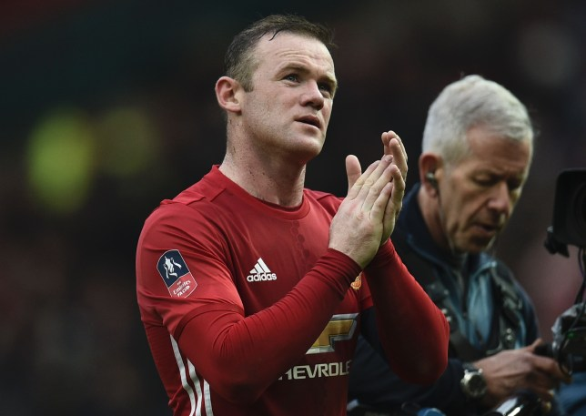 Manchester United's English striker Wayne Rooney leaves the field at the end of the English FA Cup third round football match between Manchester United and Reading at Old Trafford in Manchester, north west England, on January 7, 2017. / AFP / Oli SCARFF / RESTRICTED TO EDITORIAL USE. No use with unauthorized audio, video, data, fixture lists, club/league logos or 'live' services. Online in-match use limited to 75 images, no video emulation. No use in betting, games or single club/league/player publications.  /         (Photo credit should read OLI SCARFF/AFP/Getty Images)