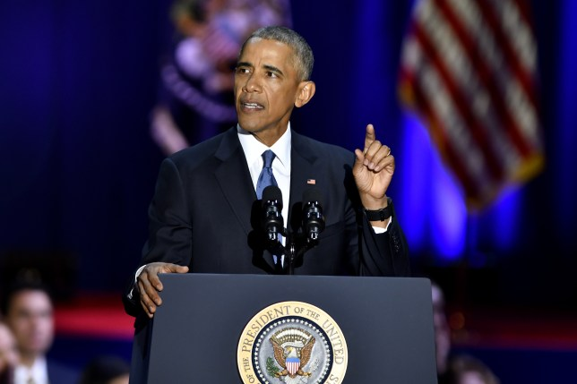 """U.S. President Barack Obama gestures during his farewell address in Chicago, Illinois, U.S., on Tuesday, Jan. 10, 2017. Obama blasted """"zero-sum"""" politics as he drew a sharp contrast with his successor in his farewell address Tuesday night, acknowledging that despite his historic election eight years ago his vision for the country will exit the White House with him. Photographer: Christopher Dilts/Bloomberg via Getty Images"""