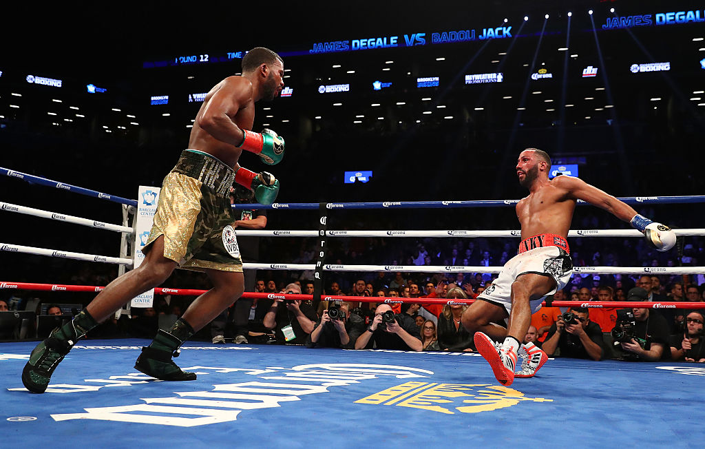 Referee punched in face as James DeGale retains IBF title in draw with Badou Jack