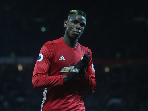 Manchester United star Paul Pogba gets some advice from Wigan boss Warren Joyce