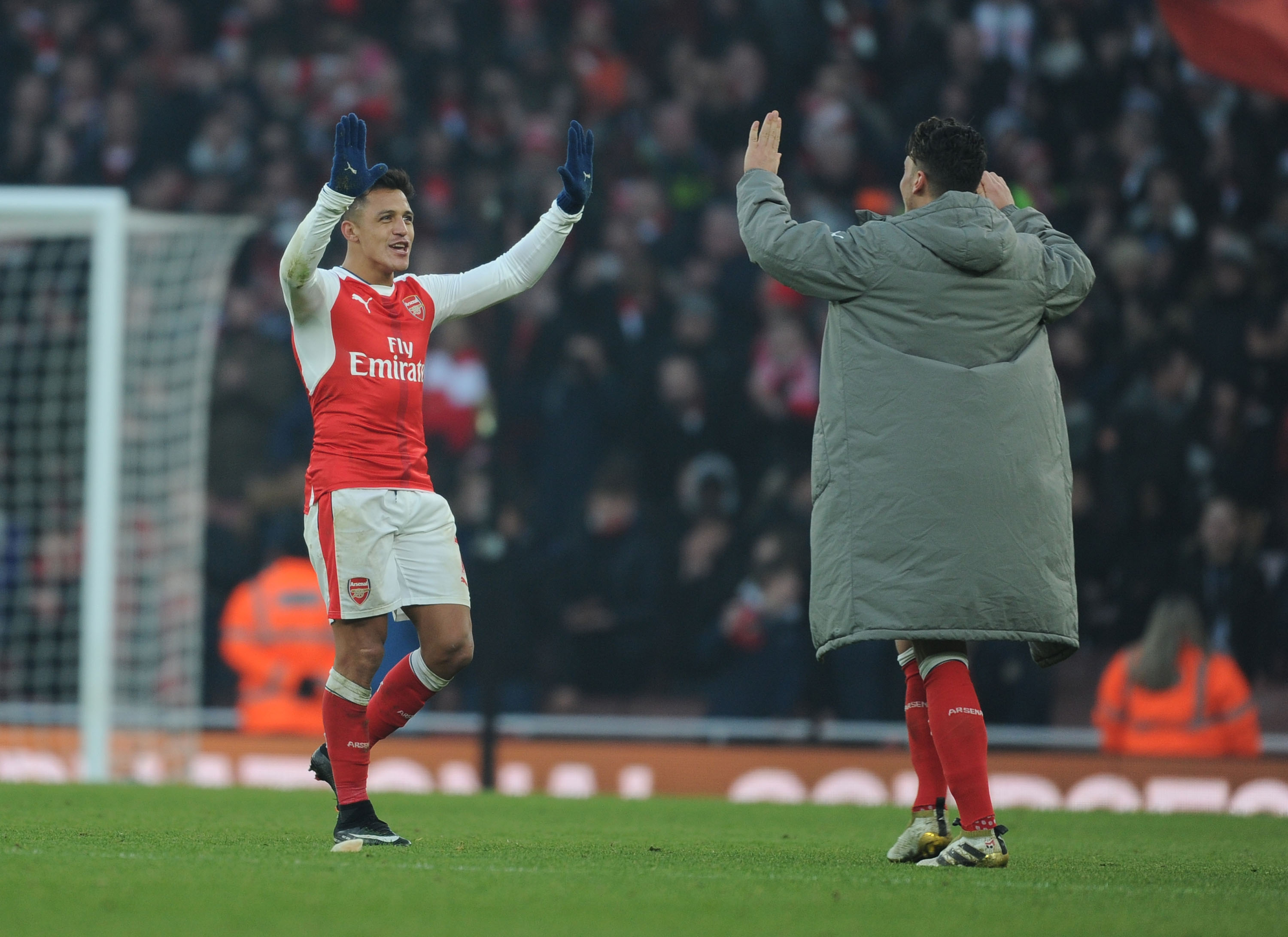 LONDON, ENGLAND - JANUARY 22:  (L-R) Alexis Sanchez and Mesut Ozil celebrates Arsenal's victory after the Premier League match between Arsenal and Burnley at Emirates Stadium on January 22, 2017 in London, England.  (Photo by Stuart MacFarlane/Arsenal FC via Getty Images)