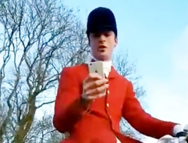 """This is the extraordinary moment a Tory councillor appears to try and silence claims he was illegally hunting a fox by telling a female activist: """"I'd quite like to SHAG you."""" See SWNS story SWHUNT. Middleton hunt master Charles Carter, 33, is filmed telling the woman that she is """"very pretty"""" before requesting her number and asking: """"Can I take you to bed please?"""" The young Breckland Council member made the remarks after being challenged by activists during a meet of the Middleton Hunt, North Yorks. Police confirmed they are investigating the incident and constituents and animal rights activists have since called for Carter to resign or be sacked."""