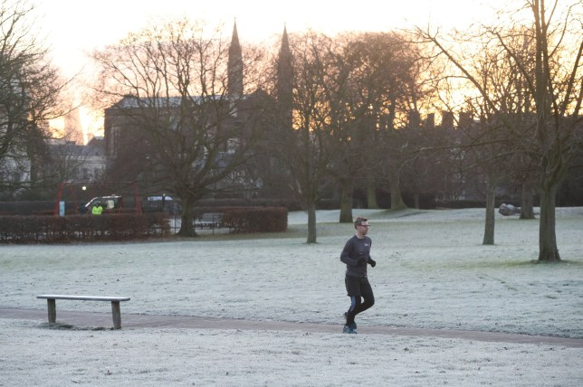 """A jogger runs through a frost-covered Regent's Park in London after forecasters issued a """"yellow"""" weather alert for ice across parts of southern England, warning some roads could become """"hazardous"""". PRESS ASSOCIATION Photo. Picture date: Tuesday January 3, 2017. See PA story WEATHER Ice. Photo credit should read: Jonathan Brady/PA Wire"""