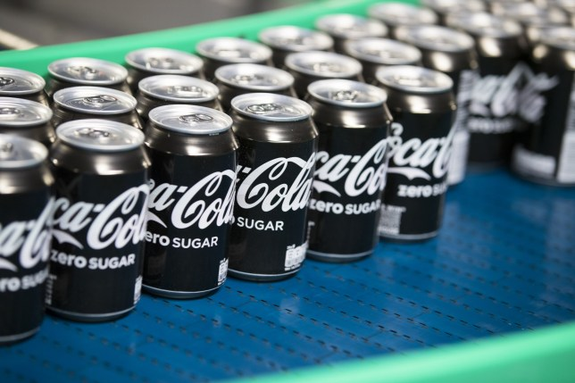 Sealed cans of Coke Zero sugar free soft drink move along a conveyor following manufacture at the Coca-Cola Co. factory in Dongen, Netherlands, on Thursday, Aug. 4, 2016. Coca-Cola, the world's largest soft-drink company, last month posted second-quarter sales that missed analysts' estimates as falling revenue abroad outweighed modest gains in the U.S. Photographer: Jasper Juinen/Bloomberg via Getty Images
