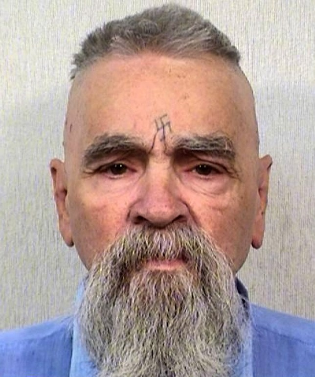 Enterprise News and Pictures 4/1/17 Pic shows: Notorious mass murderer Charles Manson, now aged 82, shown in the latest prison mugshot of him taken in August 2014. Manson is shown staring straight ahead with a full grey beard and short cropped grey hair in a photo provided by the California Department of Corrections. He bears the swastiki he carved into his forehead at his trial where he was found guilty of involvement in seven murders, including actress Sharon Tate, and was later found guilty of two more killings. Cult leader Manson was removed from Corcoran State Prison on Tuesday and hospitalised an hour away in Bakersfield due to an undisclosed illness. He is reported to be seriously ill. Manson has been behind bars for more than 40 years after being jailed for a series of cult murders in 1969. See story...
